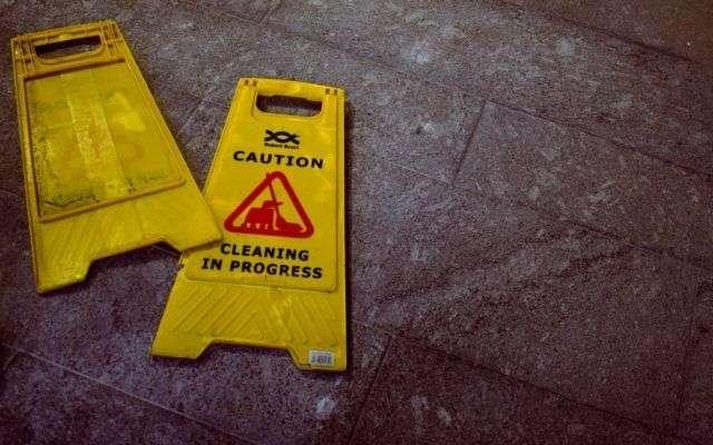 Broken Caution Sign Warning Of Wet Floor