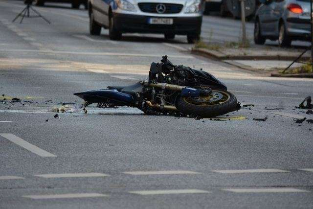 Shattered Motorcycle Parts Litter The Asphalt After A Motorcycle Accident