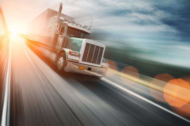 Truck Driving Fast With Blurred Background